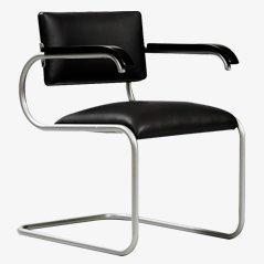 Silla de escritorio modernista con tapicería de cuero negro