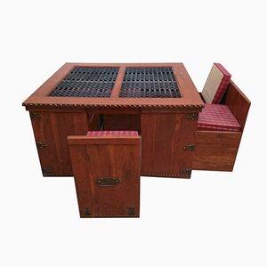 Set antico di un tavolo a forma di forziere e 6 sedie