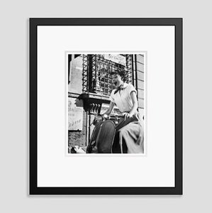 Audrey Hepburn On A Motorscooter Archival Pigment Print Framed In Black by Bettmann