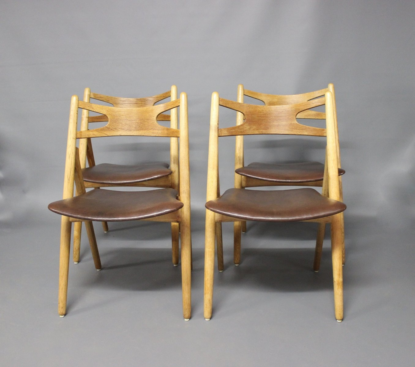 modell ch24 sawbuck st hle von hans j wegner f r carl hansen 1960er 4er set bei pamono kaufen. Black Bedroom Furniture Sets. Home Design Ideas