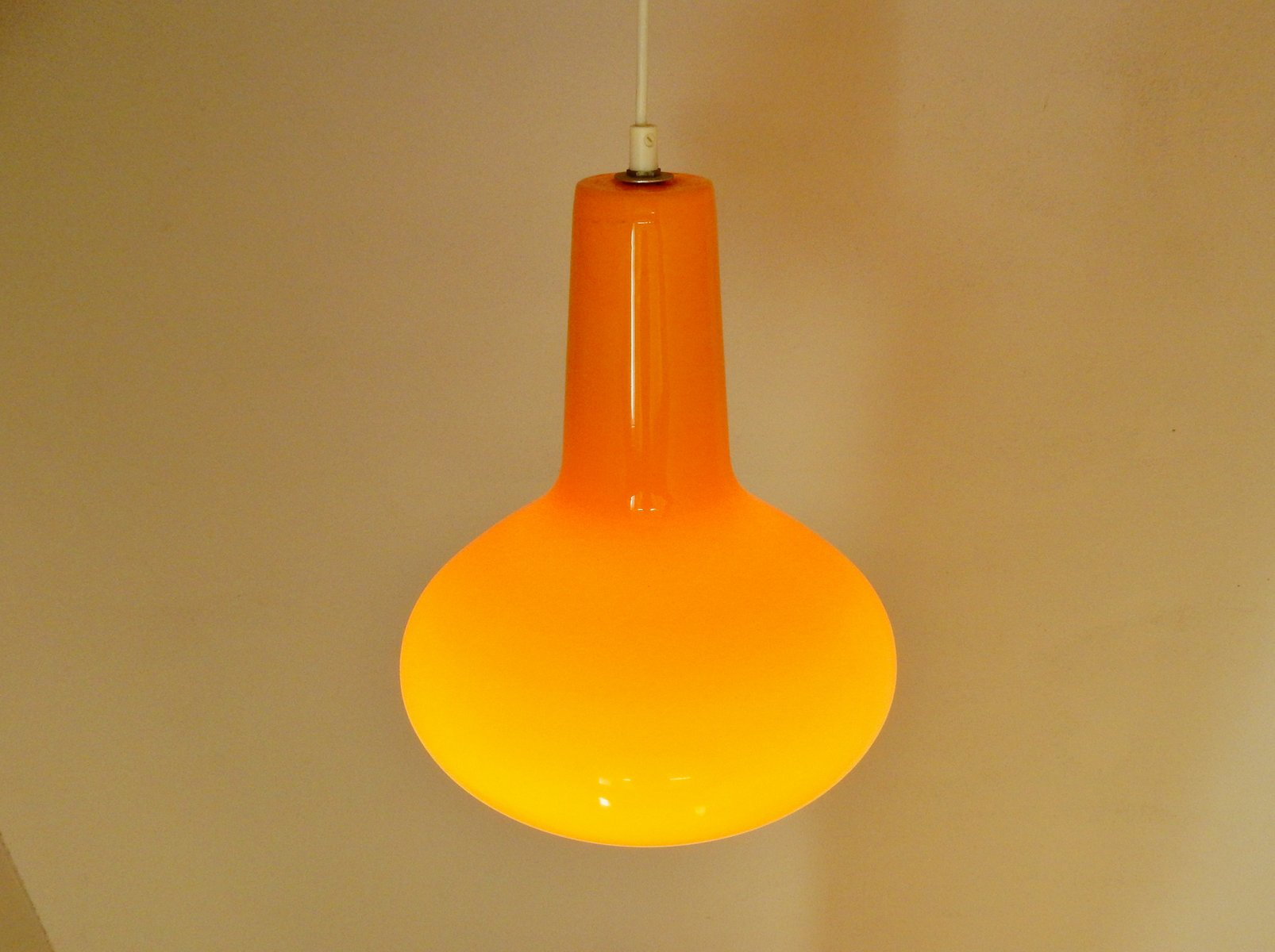 Orange italian glass pendant light by massimo vignelli for venini 1960s