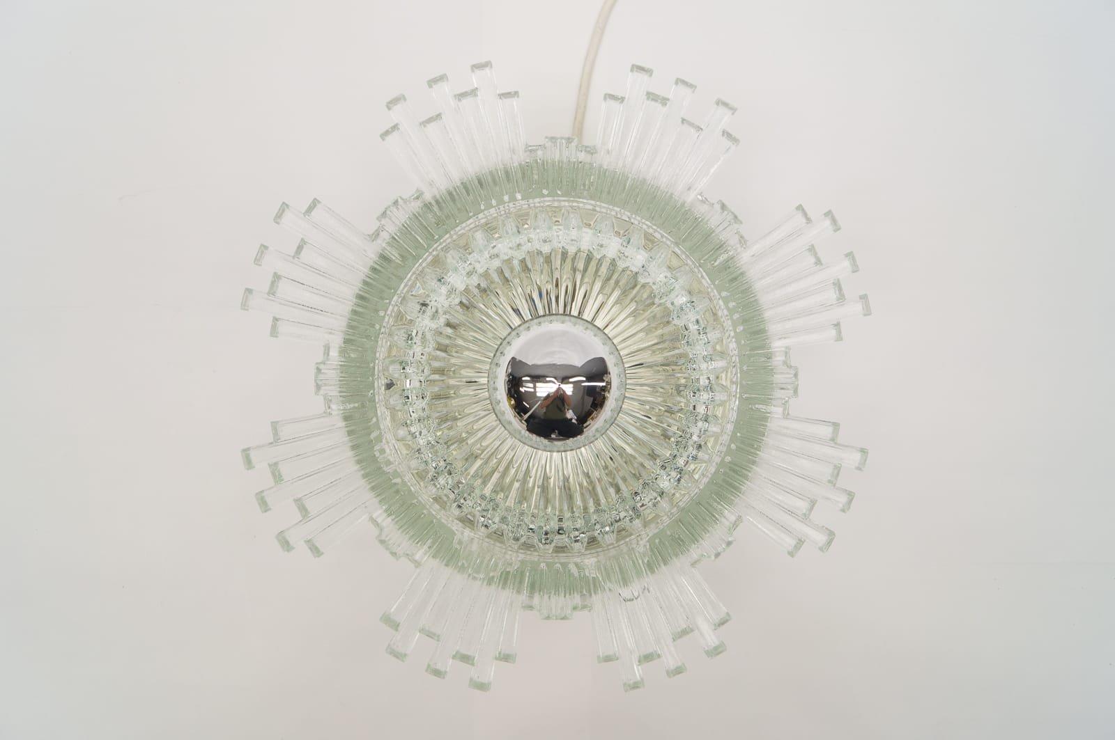 Wandleuchte aus Klarglas in Sonnen Optik, 1960er