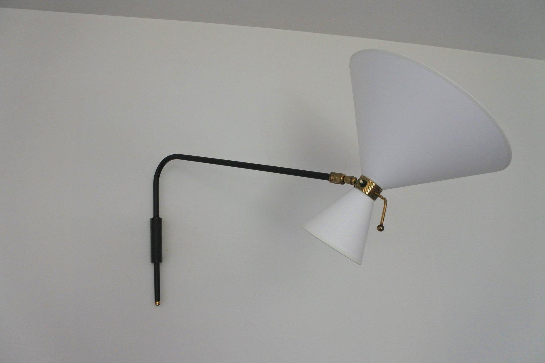 applique murale avec bras articul en laiton et m tal. Black Bedroom Furniture Sets. Home Design Ideas