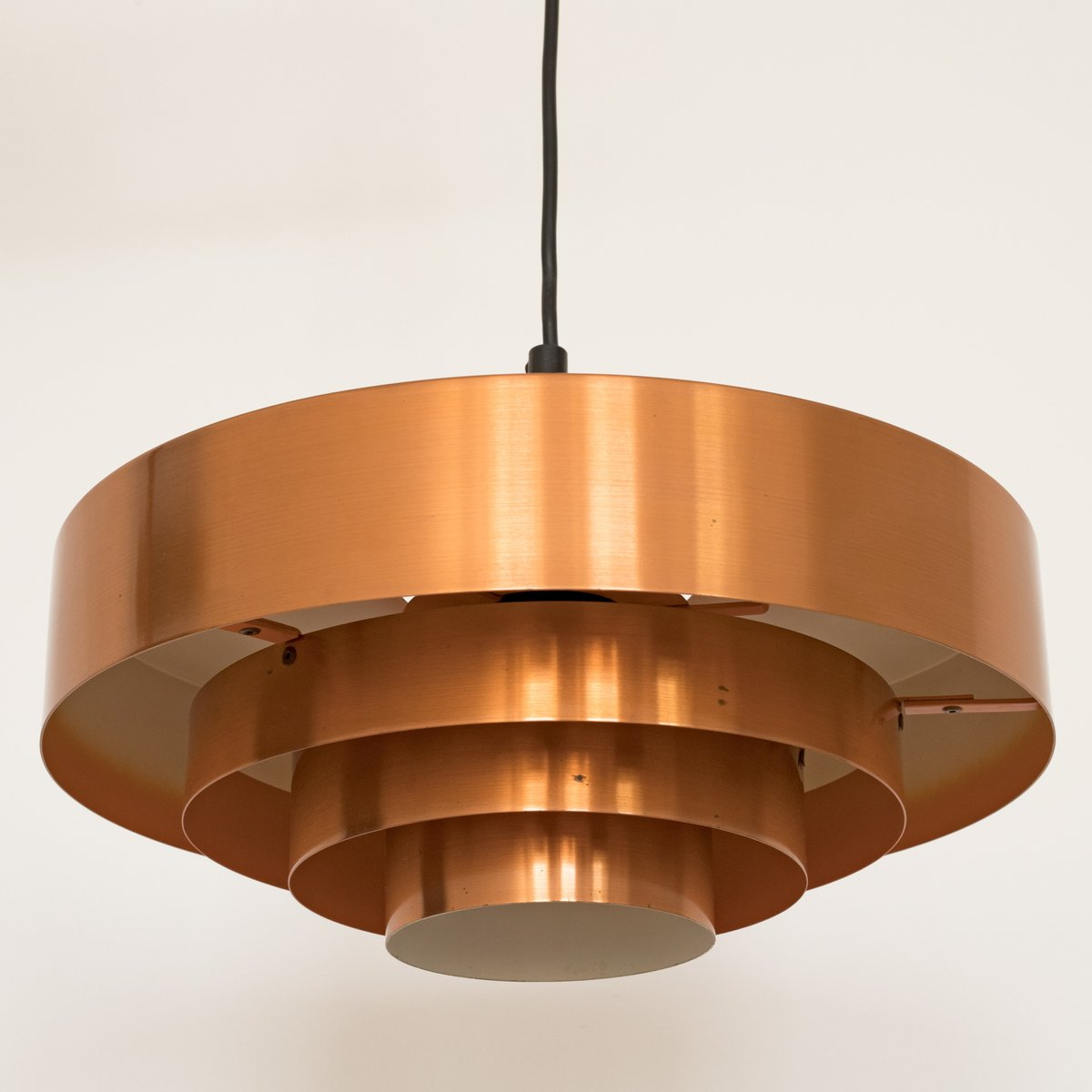 A Graphic Light Box And A Mid Century Dresser Turning The: Roulet Spun Copper Pendant Light By Jo Hammerborg For Fog