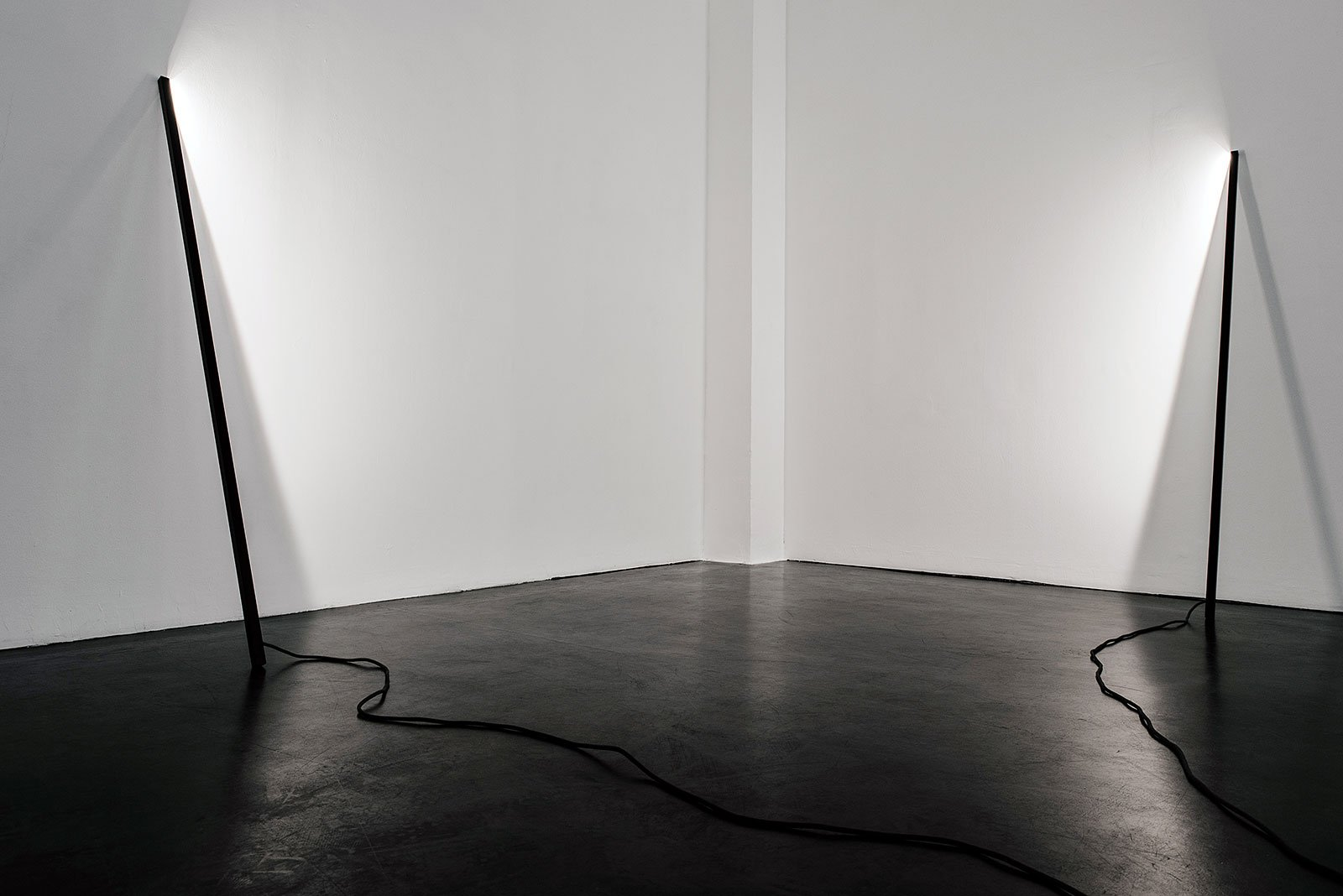L1 Floor Lamp A Pure Line Leaning Against The Wall By