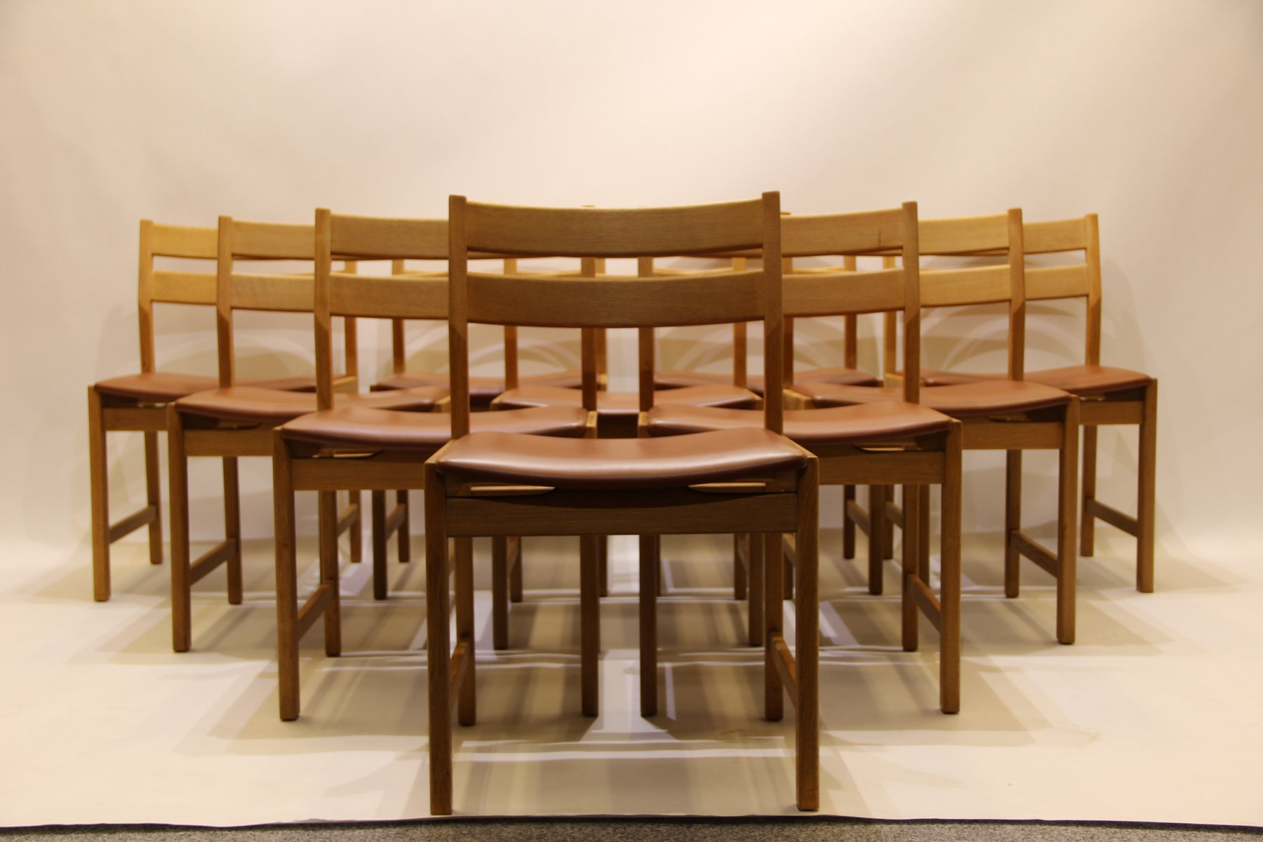 Vintage danish dining chairs in oak and brown leather by kurt østervig for kp mølber set of 10