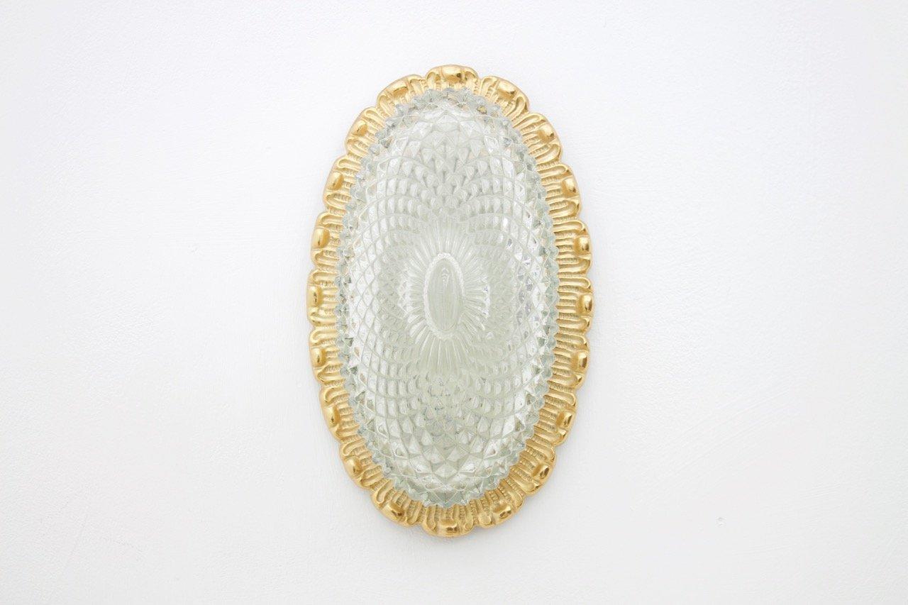 Applique murale ovale en verre texturé métal doré de limburg