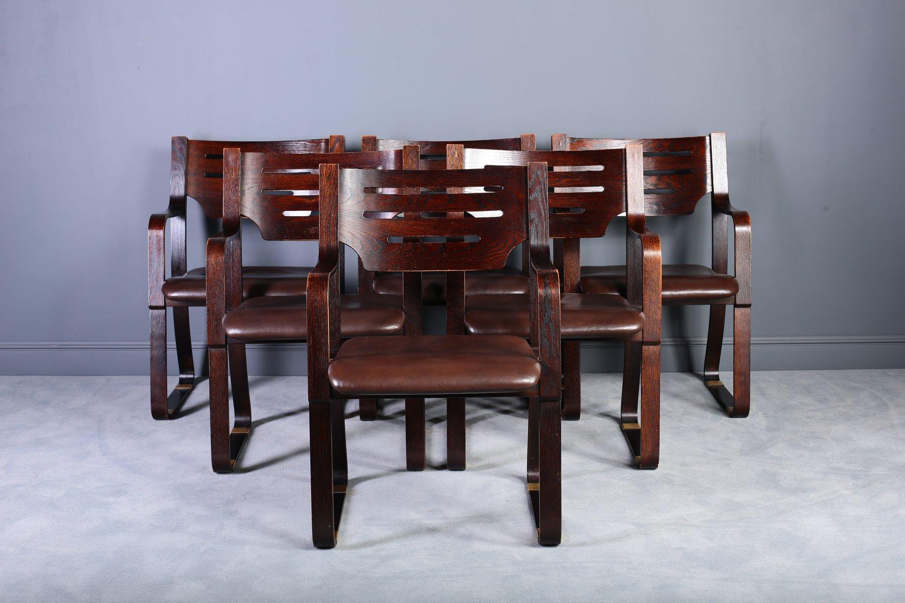 Sillas de comedor de cuero y madera curvada a os 60 for Precio de juego de comedor de madera de 6 sillas