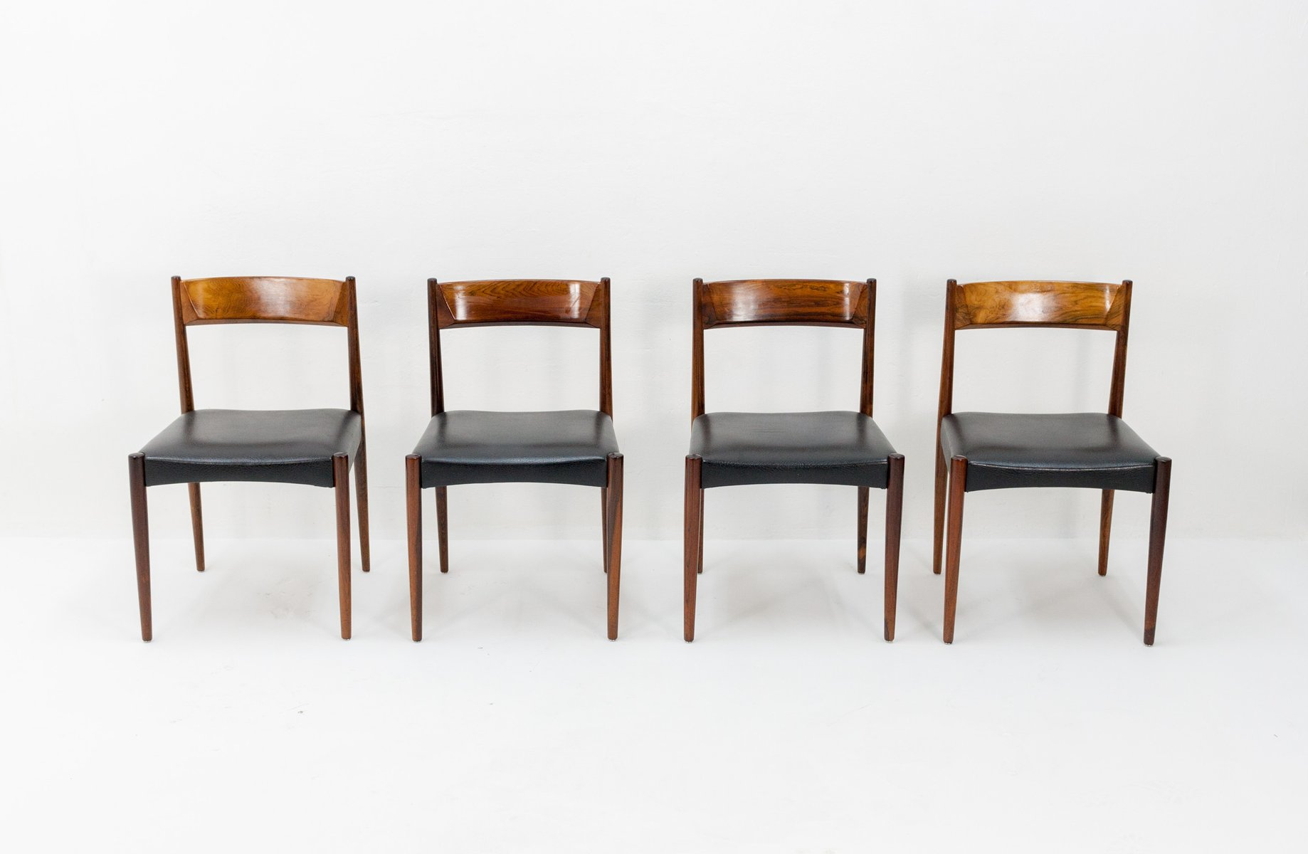 Rosewood and black leather dining chairs from lübke 1960s set of 4