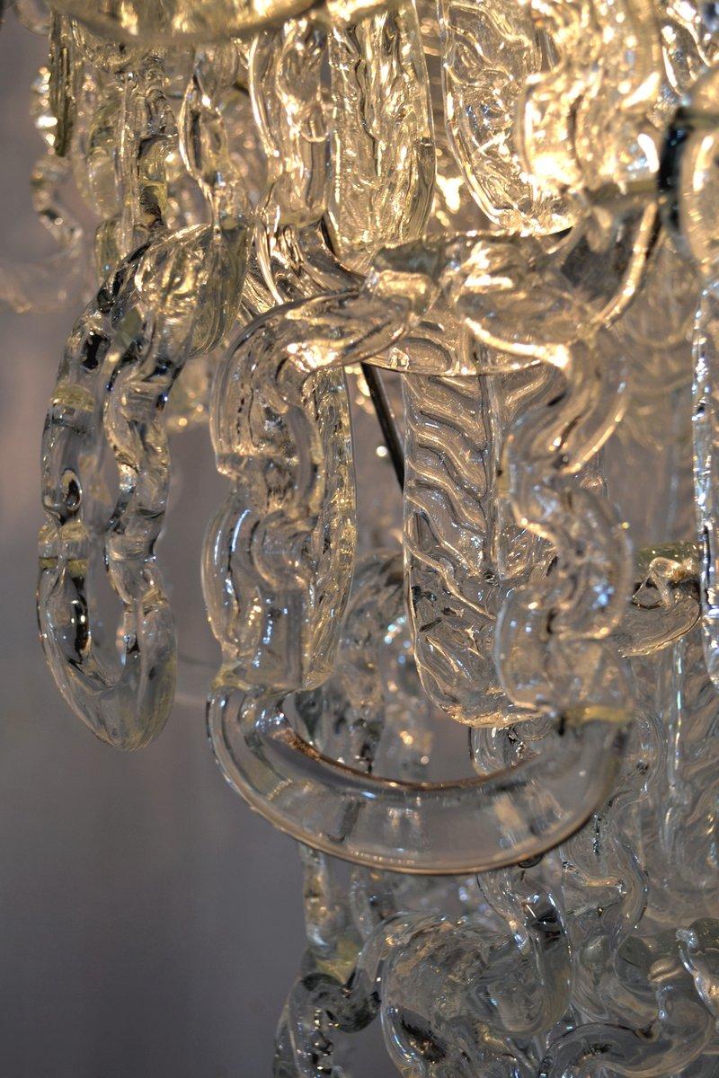 Lampadario con catene in vetro di angelo mangiarotti per for Catene di arredamento