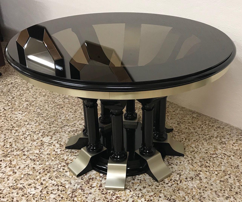 runder esstisch aus chrom schwarz lackiertem holz. Black Bedroom Furniture Sets. Home Design Ideas