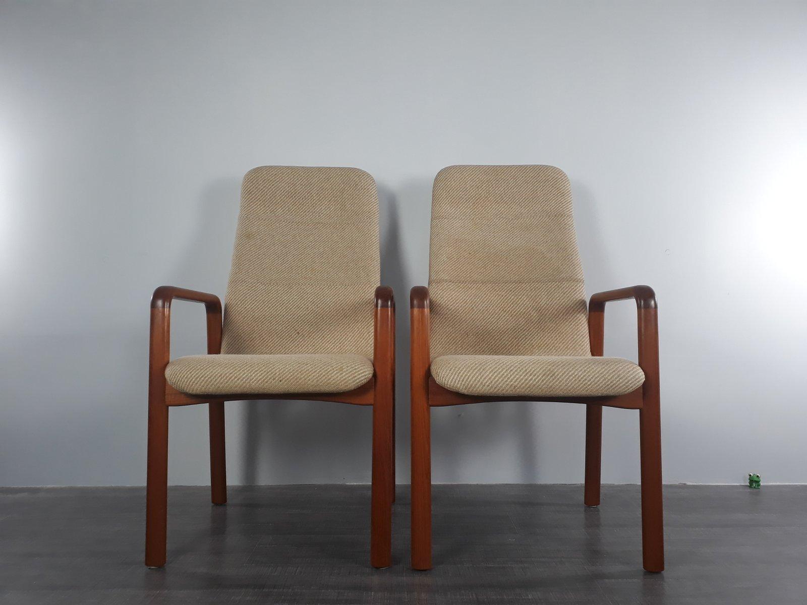 Dänische Armlehnstühle aus massivem Teak von Dyrlund, 1960er, 2er Set