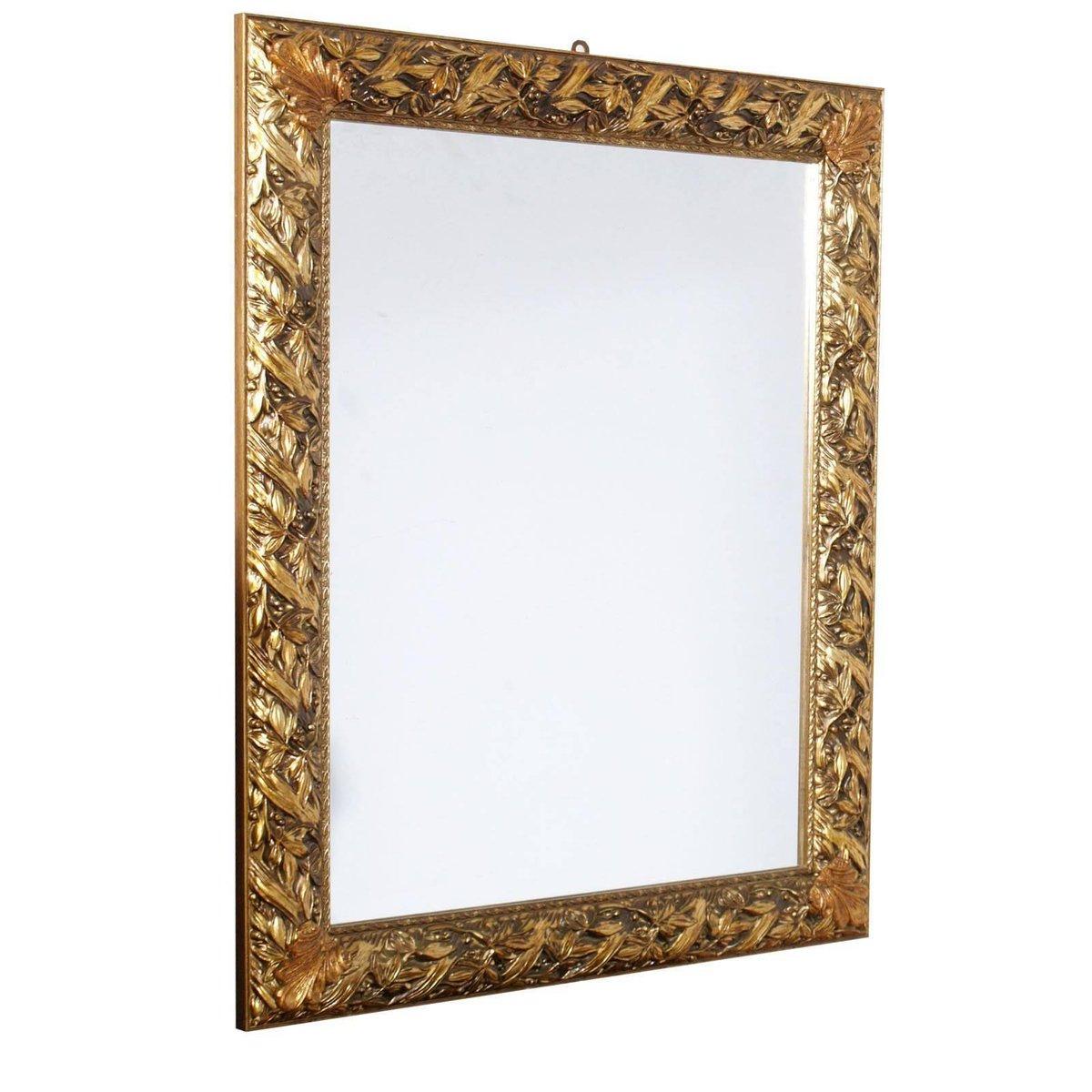 Specchio vintage con cornice dorata ed intagliata in - Specchio con cornice dorata ...