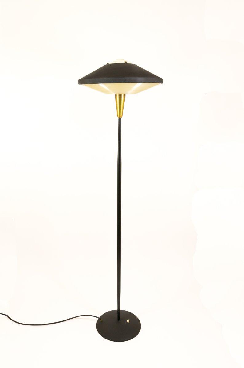 Black metal brass floor lamp by louis kalff for philips 1950s for black metal brass floor lamp by louis kalff for philips 1950s aloadofball Gallery