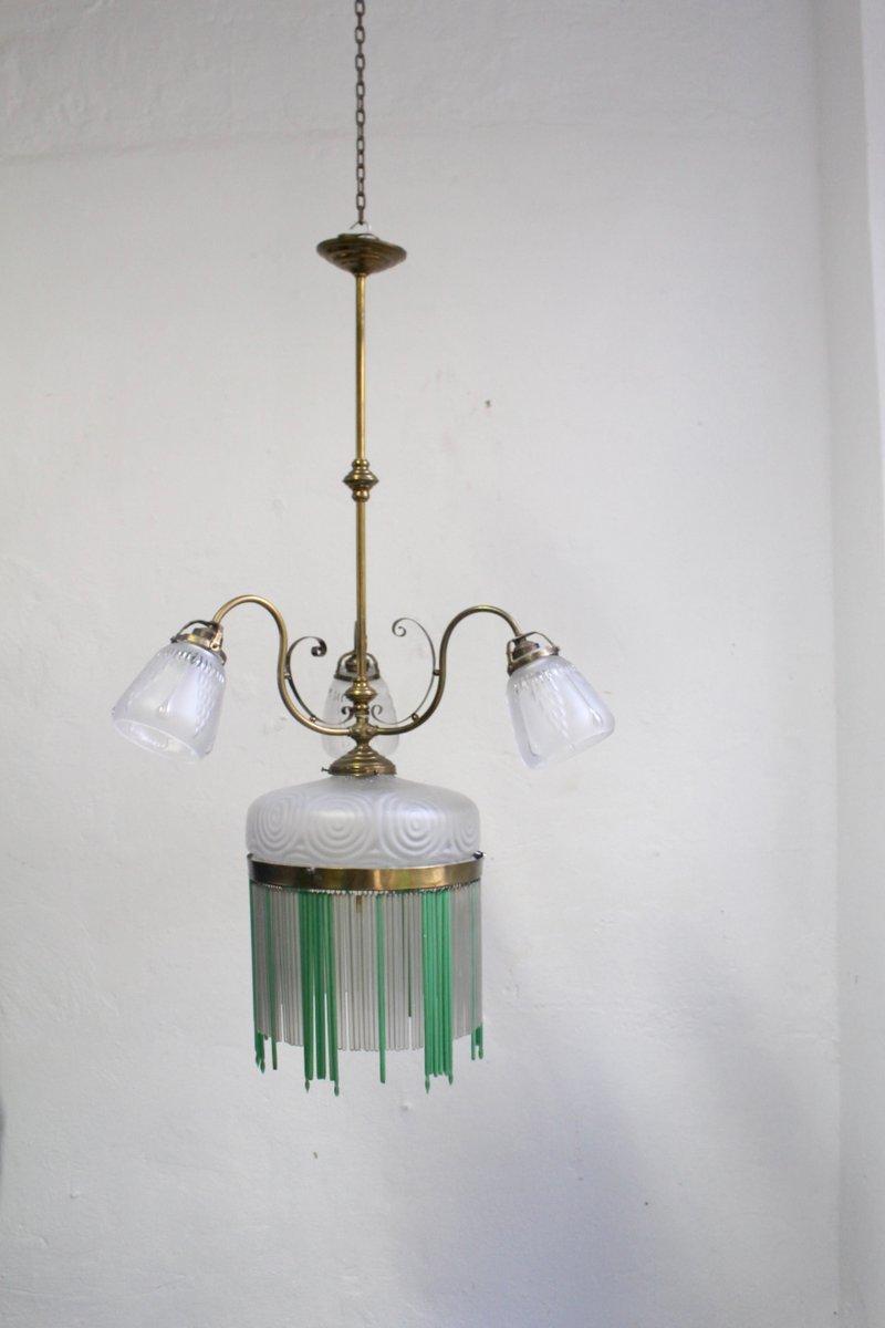 Antike Deckenlampe aus Messing & geschwungenem Glas