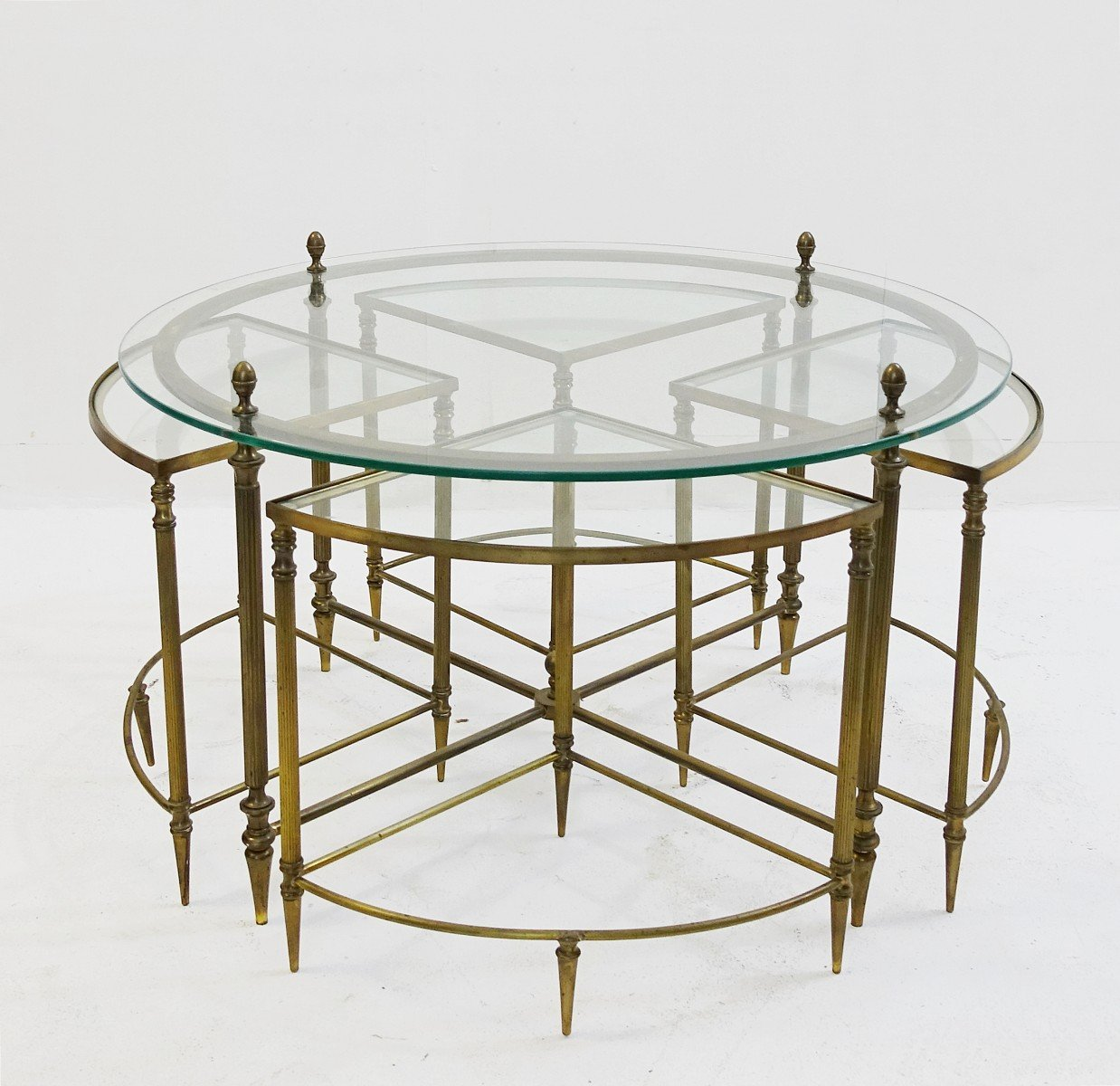 Round vintage brass coffee table with 4 nesting tables