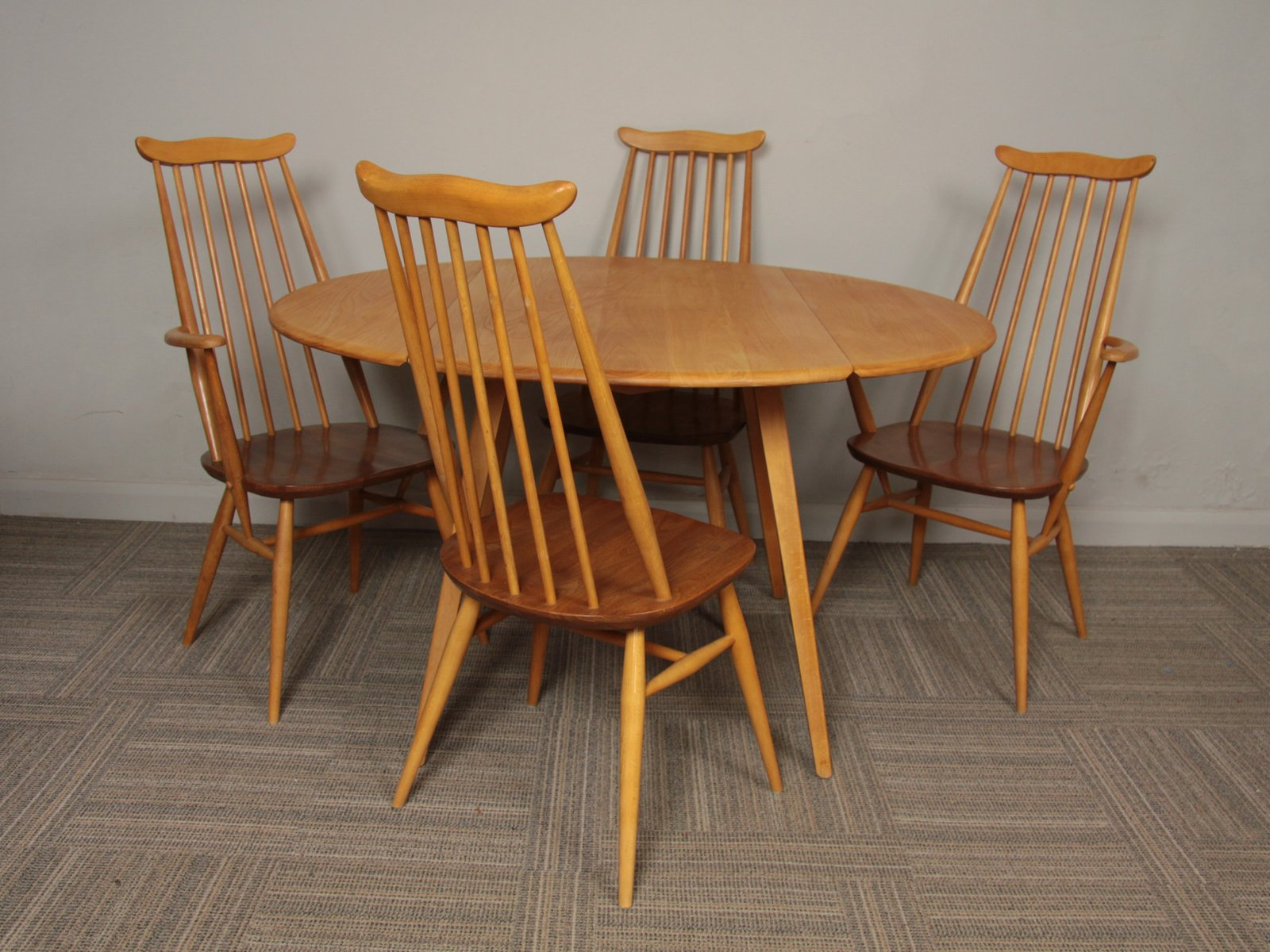 Beech Elm Oval Drop Leaf Dining Table From Ercol With 4 Chairs