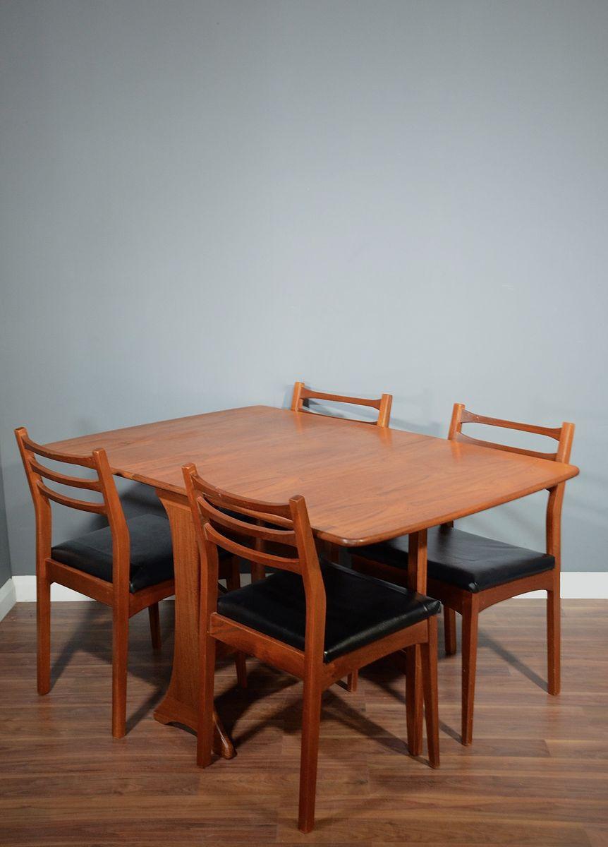 Ausziehbarer Mid-Century Tisch und 4 Stühle aus Teak von Ib Kofod-Lars...