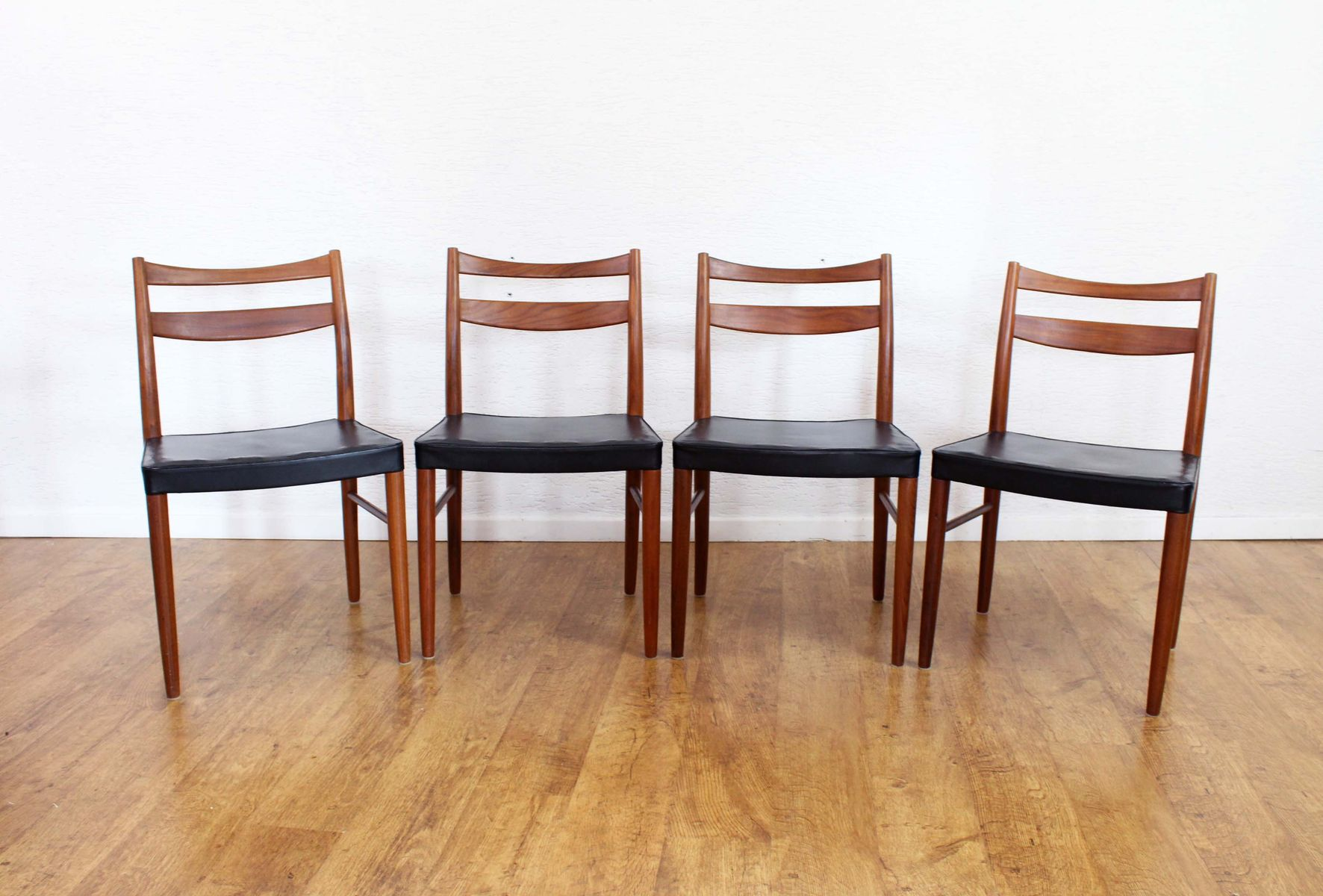 Vintage Teak And Black Vinyl Dining Chairs Set Of 4 For