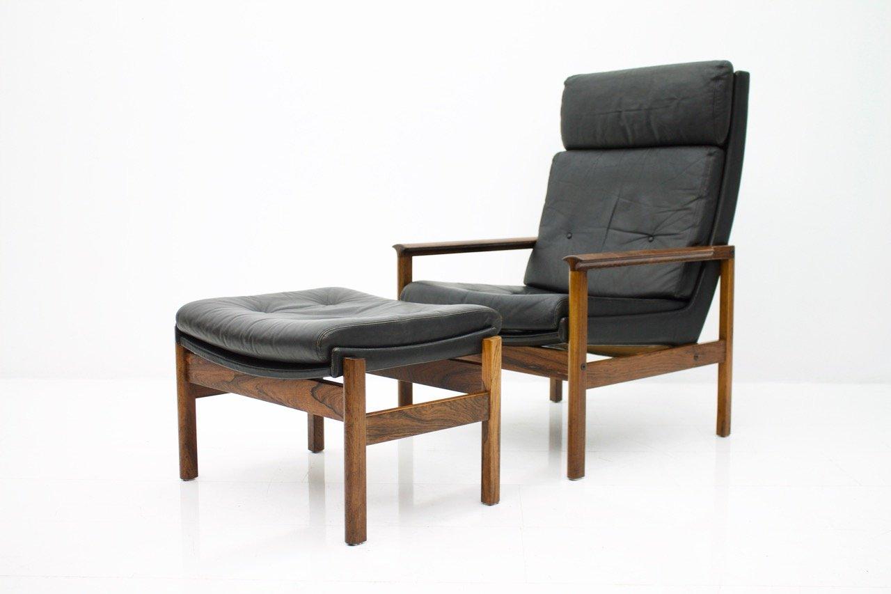 skandinavischer sessel mit hoher r ckenlehne fu hocker. Black Bedroom Furniture Sets. Home Design Ideas