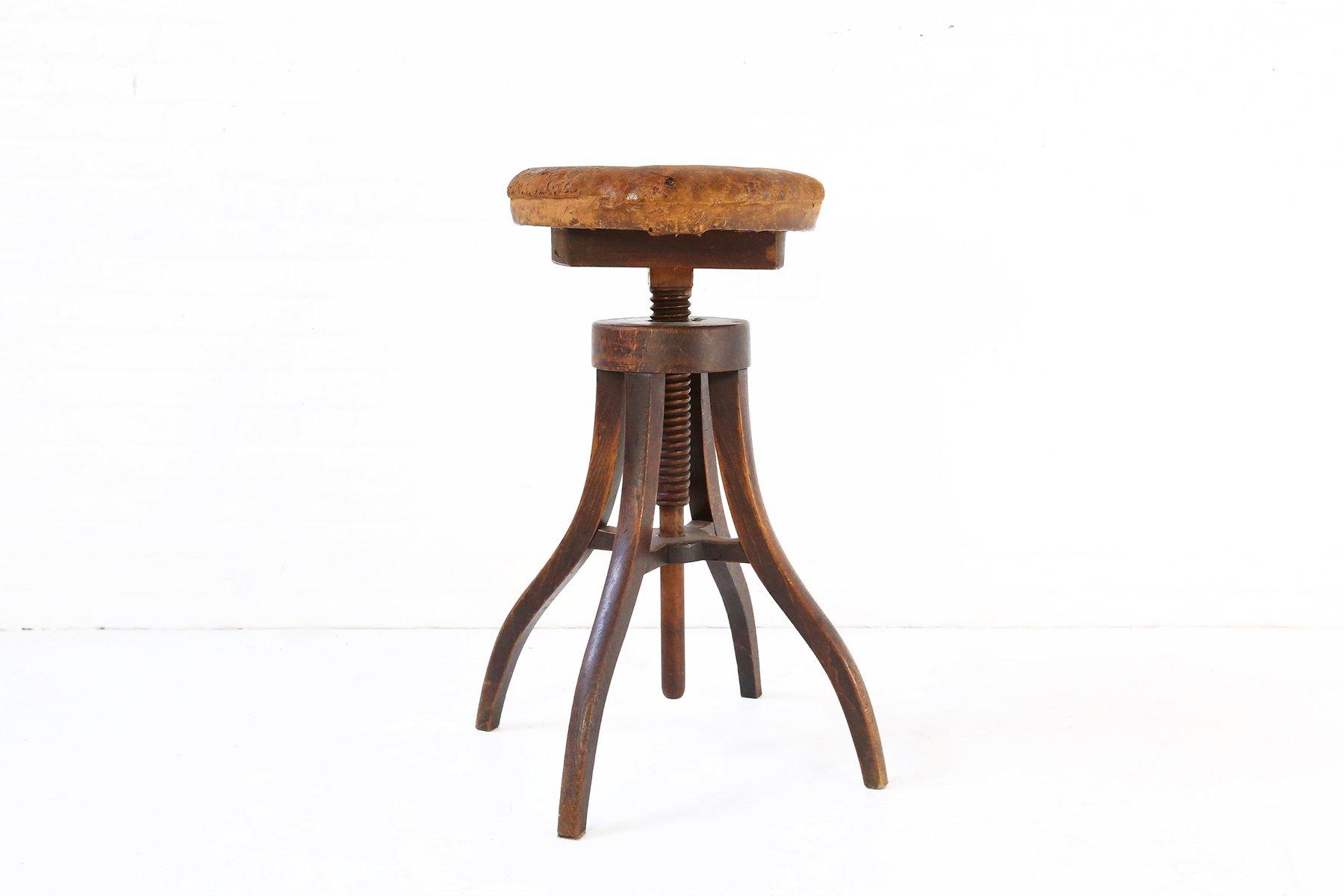Sgabello regolabile antico in legno e pelle danimarca in vendita su