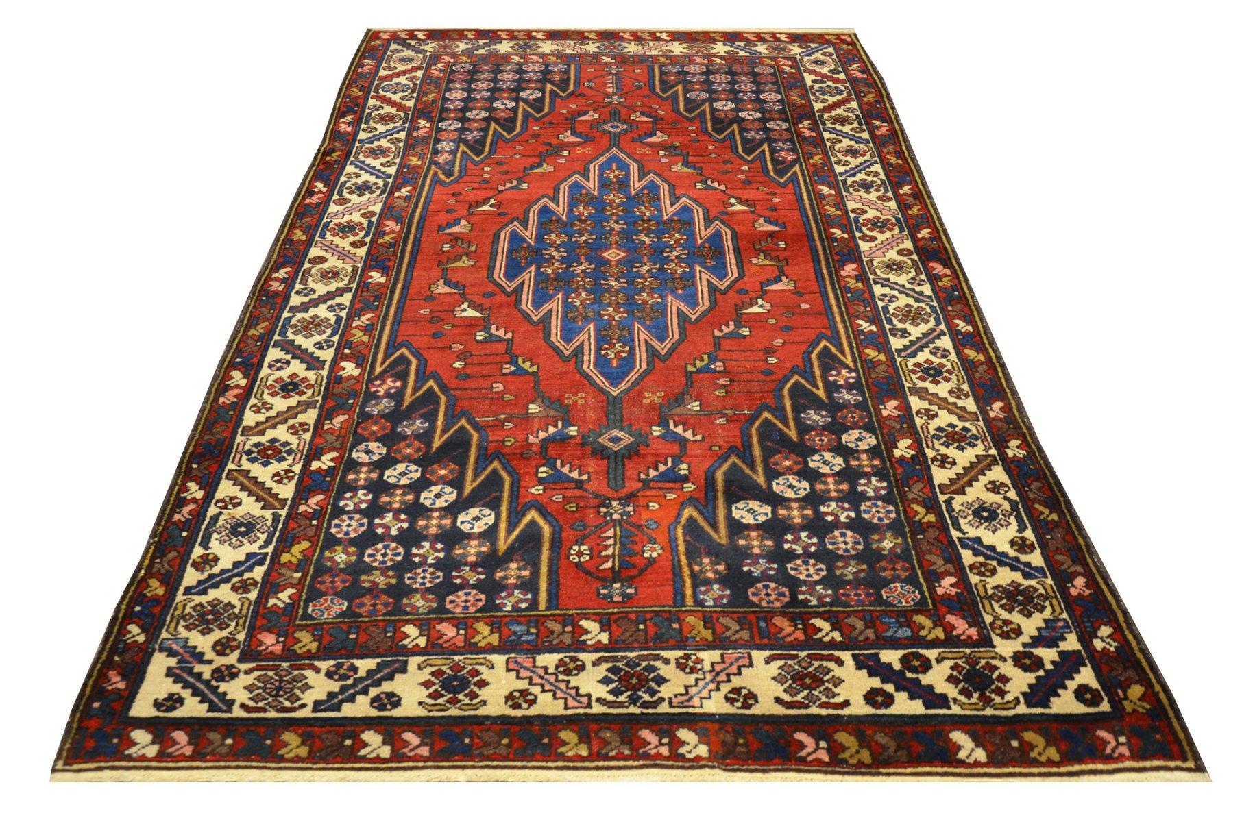 persischer sirjan teppich aus wolle in rot ber blauem hintergrund 1920er bei pamono kaufen. Black Bedroom Furniture Sets. Home Design Ideas