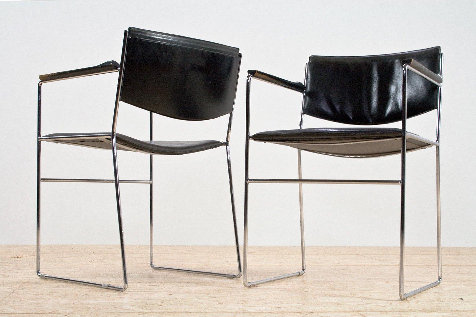 Sedie da pranzo moderne in pelle nera e acciaio italia for Sedie design anni 20
