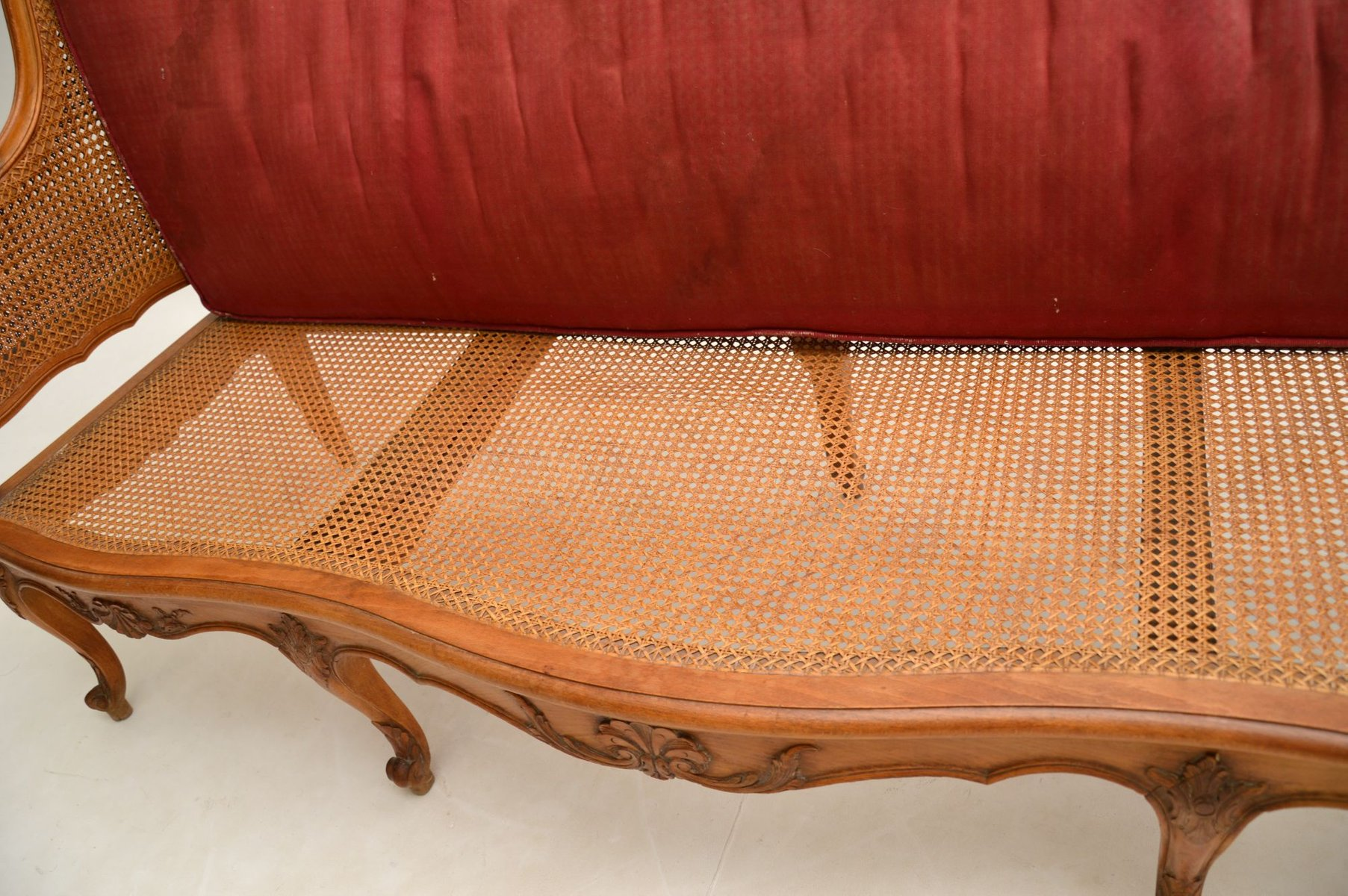 Antique French Carved Walnut Bergere Sofa for sale at Pamono