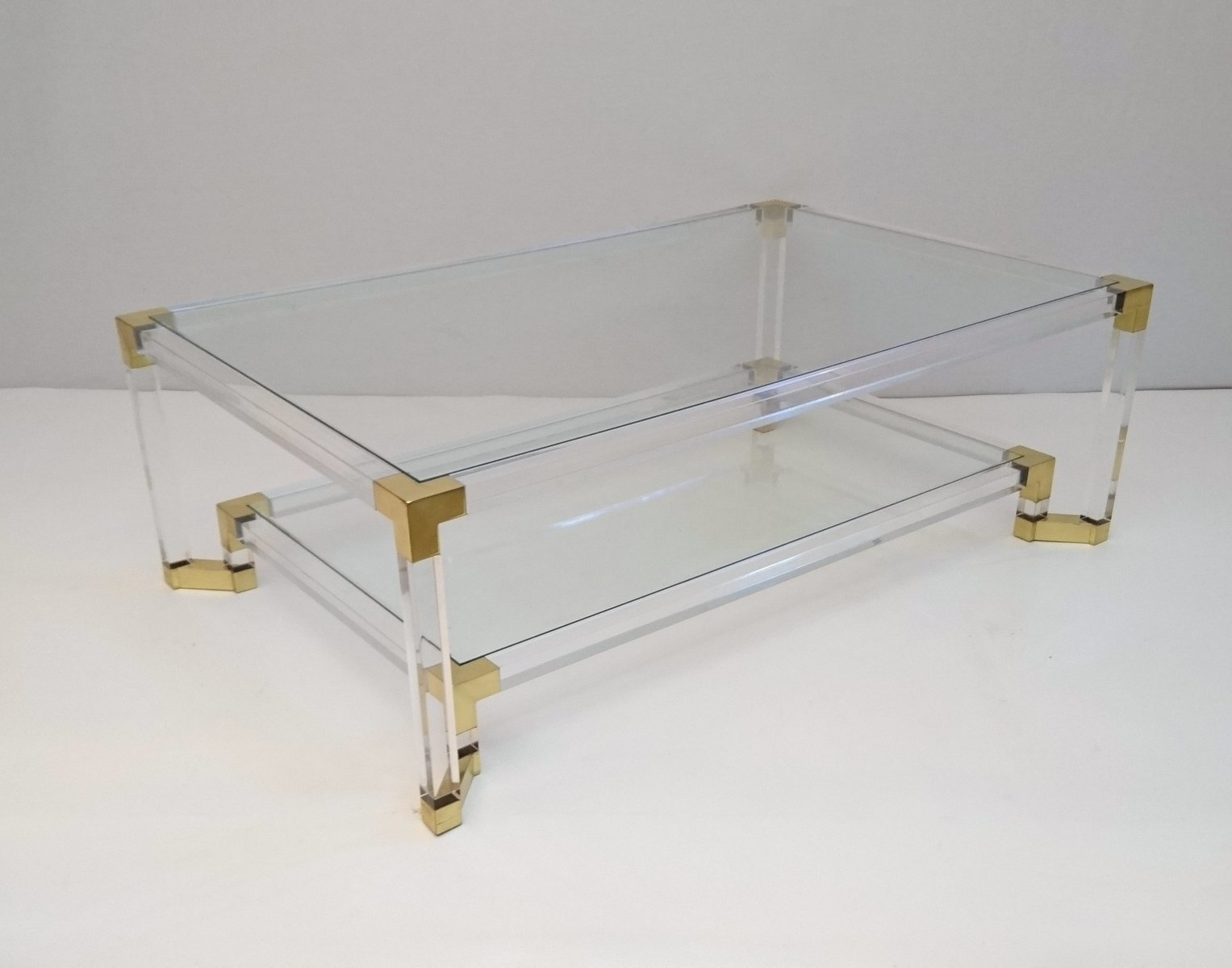 Vintage Lucite and Brass Two-Tiered Coffee Table for sale at Pamono